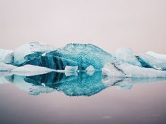 """Freia Lily (photographer) """"still waters of Jökulsárlón,"""" a """"glacier lagoon"""" in Iceland. From National Geographic."""