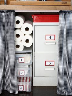 Under-the-sink    Think above & below for finding extra storage: above bookcases, cabinets, & shelves, & below sinks, countertops, & tables.   -- Use discount store plastic shelves where they fit to separate dish towels, washcloths, and cleaning supplies.  -- Use a small file cabinet to store house records or take out the folders and use the cabinet as extra kitchen drawers.