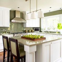 Horizontal green tile adds color to this neutral kitchen! More kitchen inspiration: http://www.bhg.com/kitchen/styles/traditional/traditional-kitchen-ideas/?socsrc=bhgpin041812greentilekitchen