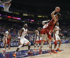 arkansas basketball | Photo - Arkansas's Dusty Hannahs, right, shoots over Florida's John ...