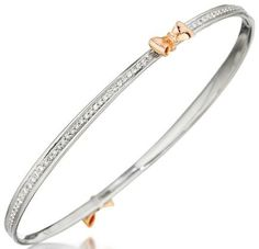 White gold, rose gold, and diamond bow bracelet by Mimi So. Via Diamonds in the Library.