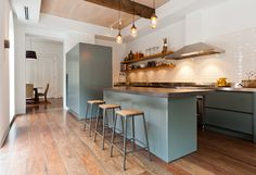 kitchen colours and materials...concrete combined with stainless steel.  Also green and white