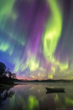 Aurora Borealis reflected upon a serene lake