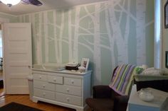 I am doing a mural similar to this in Konnor's room. His walls are a grey blue and I am doing the birch trees in a charcoal silver and giving it some sheen. His colors will make it look more masculine and contemporary