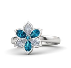 Round White Sapphire White Gold Ring with Aquamarine and Blue Topaz - Enchanting Flower Ring: Six gemstone petals surround a round-cut stone in this stylish flower ring, carefully handcrafted in your choice of gems and metals. Yellow Gold Rings, Silver Rings, Silver Jewelry, Gold Jewellery, Ring Rosegold, Pink Sapphire, Topaz, Amethyst, Peridot