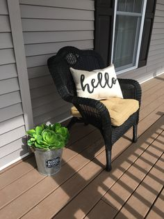 Painting used porch furniture. Upgraded old wicker furniture with black spray paint.