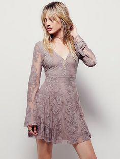 """Reign Over Me Lace Dress   Deep """"V"""" mini dress with a sheer mesh overlay featuring a beautiful embroidered design with scalloped trim. Hidden side zip.  Lined."""