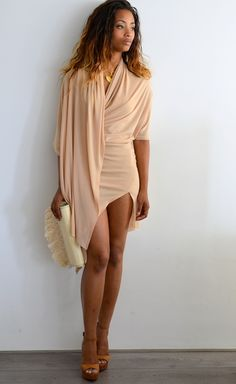 wearing a nude dress is tricky but with the volume of the layers and the asymmetrical cut, this looks awesome!