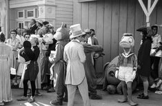 July 17, 1955 Costumed actors prepare for the parade celebrating opening of Disneyland. Image: Allan Grant/The LIFE Picture Collection/Getty Images