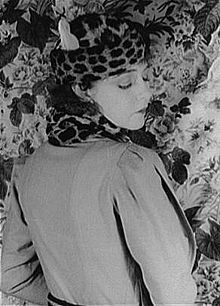 In the 1930's the with at the shoulders was achieved by many means. In this photo is Dorothy Gish wearing  an outfit of 1932, the width is in the sleeve cap, which is pleated into the sleeves.