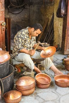 One of many talented craftsmen we saw in Fes Morocco. For more photos and tips on visiting Morocco read the article.