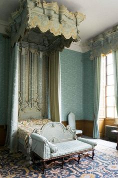"The Blue Bedroom at Belton House, Lincolnshire, UK. The bed is early C18th, in the style of Francis Lapiere, a Huguenot craftsman. The bed was reupholstered in 1813 in blue silk damask and may have been converted to the ""angel tester"" form at the same time. The day-bed at its foot is late C17th."