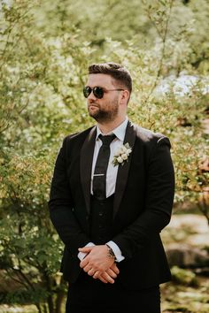 Groom in Black Wedding Suit and Sunglasses | By Sheena T Photography | Luxe Wedding | White Wedding Bouquet | White Wedding Flowers | Off The Shoulder Wedding Dress | Bridal Bun with Veil | Intimate Wedding White Wedding Bouquets, Wedding Bridesmaid Dresses, Bridal Dresses, Black Suit Wedding, Wedding Suits, Bridal Bun, Bridal Lace, Luxe Wedding, Grace Loves Lace