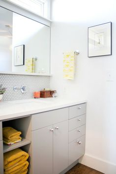 open shelves for guest bath, so they don't have to search and you don't have to leave towels on the counter