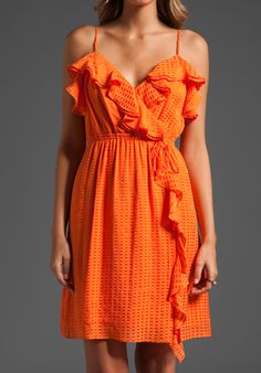 Bridesmaids would love a shift from the typical to a tangerine dress that's wearable all summer!