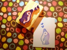 Penguin with hearts  hand carved rubber stamp by HappieStamps