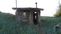 Haida Gwai Island tiny home built from bottles, bones and beach debris. Stackwood cabin off British Columbia coast.