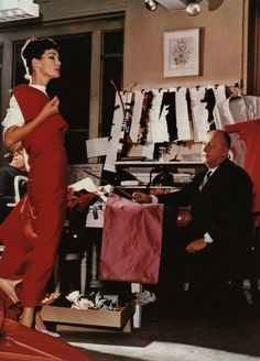 Christian Dior working with his house model, Lucky, 1950s.