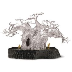 Having the most bizarre appearance on the African skyline, the Baobab tree has inspired many tribes to call it the 'Upside Down Tree'. Tree Sculpture, Sculptures, Lion Sculpture, Silver Candelabra, Silver Candle Holders, Baobab Tree, Art And Architecture, African, Candles