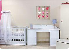Voorbeeld van een stoer geboortekaartje op canvas doek in een babykamer.