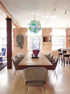 Eclectic Neutral Dining Area with Artistic Pendant Lamp