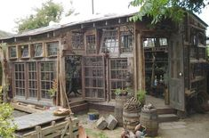 Greenhouse, potting shed from salvaged windows? Old Window Greenhouse, Greenhouse Shed, Small Greenhouse, Greenhouse Gardening, Greenhouse Wedding, Pallet Greenhouse, Outdoor Greenhouse, Old Windows, Windows And Doors