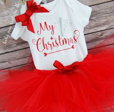 Babys 1st Christmas Outfit! - Bodysuit: My 1st Christmas in red and silver glitter vinyl - Red Tutu with elastic waist  - OR 3 pc outfits include matching ribbon bow headband  ~~~Please READ OUR FAQS at the bottom of the listing for important information including:  - shipping time frame  - brand of bodysuits  - sizing information  - This listing is for one bodysuit with vinyl customization, a tutu and a headband.