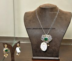 Diamond pendant set with diamonds and center square cut emerald. Paired with beautiful earrings with pearl drops, strung to a triple chain of thin white gold Gold Chain With Pendant, Pendant Set, Diamond Pendant, Gold Pendant, Pendant Jewelry, Gold Jewellery Design, Gold Jewelry, Diamond Jewellery, Jewelery