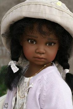 Beautiful porcelain doll by Angela Sutter