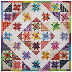 Scrappy lap and throw. Star Carousel Quilt Pattern PAD-150 by Presto Avenue Designs - Claudia Lash.  Check out our applique quilt patterns. https://www.pinterest.com/quiltwomancom/applique-quilt-patterns/  Subscribe to our mailing list for updates on new patterns and sales! https://visitor.constantcontact.com/manage/optin?v=001nInsvTYVCuDEFMt6NnF5AZm5OdNtzij2ua4k-qgFIzX6B22GyGeBWSrTG2Of_W0RDlB-QaVpNqTrhbz9y39jbLrD2dlEPkoHf_P3E6E5nBNVQNAEUs-xVA%3D%3D