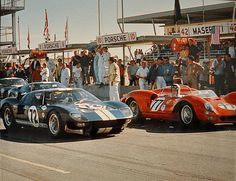 Daytona 2000 Km,1965. On the left, the Ford GT40 of Bob Bondurant (in car) and Richie Ginther. On the right, the NART Ferrari 330 P2 of John Surtees (in car) and Pedro Rodriguez. The Ferrari would fail to finish due to a busted rear axle.