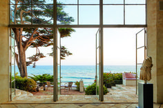 "A beach view from an amazing home  ""inspired by villas in Sicily, capturing a 'sweet ruined ambiance' by the sea"""