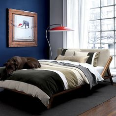 drommen bed from CB2. Love the construction of this bed and the padded headboard.  Also love the backwards picture frame art!