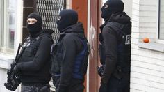 Belgian police carried out a series of raids in Brussels after the Paris attacks