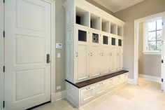 love this mudroom...especially the lockers with doors!