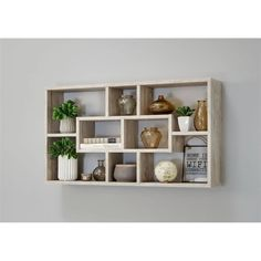 Symple Stuff This wall rack is a modern eye-catching piece that has plenty of space for books or decorations in seven original arranged compartments. Cube Wall Shelf, Unique Wall Shelves, Cube Shelves, Modern Shelving, Wall Shelves Design, Wall Mounted Shelves, Display Shelves, Floating Shelves, Wall Rack Design