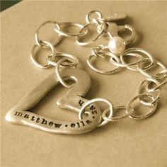 Love, love, love this molded heart bracelet from Lisa Leonard Designs....it's on my wish list!