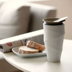 An elegant ceramic thermos/mug. A great example of refined product design.