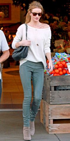 Rosie Huntington-Whiteley hit the grocery store in an off-the-shoulder thermal tucked into leather leggings. She finished the look with a Chanel purse and pointy-toe Barbara Bui boot, December 22, 2011.