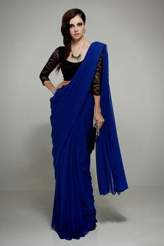 """Description The curiosity in Coraline is embraced is this effortlessly cool, royal blue chiffon sari. Styled with the Katerina P. lace saree blouse in black. Model's height is 5'9"""". Blouse sold separa"""