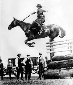 """Mrs Esther Stace, from Yarrowitch, riding sidesaddle and clearing a record 6'6"""" at the Sydney Royal Show in 1915."""