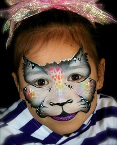Pixie's Face Painting-good use of black/grey/white split cake and animal stencil with rainbow cake.