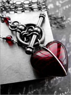 Valentines Day gift - dark red Murano glass heart pendant necklace wrapped in oxidized sterling silver wire with gunmetal black toggle clasp and long chain.