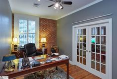 With natural lighting, exposed brick, and French doors, working from this Greenville, SC isn't so bad at all!