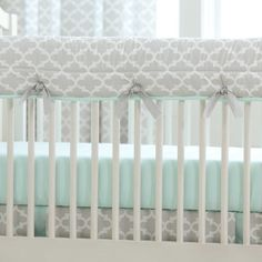 "French Gray and Mint Quatrefoil Crib Rail Cover | Carousel Designs.  A perfect solution to help protect your baby's crib while maintaining a stylish decor for your nursery. Our Crib Rail Cover is reversible, enabling you to change the visible side at a moment's notice. Simply wrap the cover around your crib rail, pull the ties though the buttonhole and tie. The crib rail cover measures approximately 50"" long by 18"" wide. Each cover is quilted using batting made with recyclable…"