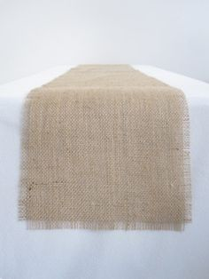 14x72 in.. fringed natural burlap table runners edges are not sewn. Beautiful on your wedding tables.