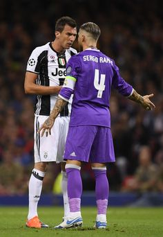 Mario Mandzukic of Juventus and Sergio Ramos of Real Madrid exchange words during the UEFA Champions League Final between Juventus and Real Madrid at National Stadium of Wales on June 3, 2017 in Cardiff, Wales.