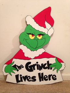 Grinch with sign christmas yard art decoration
