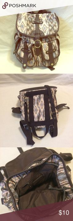 Backpack Four pockets on outside. Resizable straps. Closed by string and flap. In great condition. Bags Backpacks