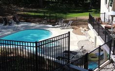 Black ornamental aluminum 3 rail high pool fence with pickets. Made in Michigan exclusively for Fence Consultants of West Michigan - we also furnished and installed the ornamental aluminum railing. How To Wear Ankle Boots, Aluminum Fence, Pool Fence, Michigan, Yard, Ornaments, Outdoor Decor, Black, Design